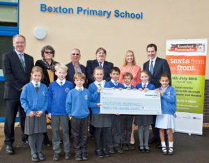(Back row, from left) Bexton Primary School headteacher Paul Dolan, Knutsord Promenades organisers Julie Tempest and Robert Meadows, Cheshire East Council Leader Councillor Michael Jones, Promenades originator Sarah Flannery and Tatton MP Chancellor of the Exchequer George Osborne, alongside some Year 4 pupils (front) at Bexton Primary