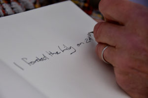 Signing the Legacy Book