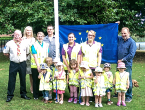 Mark Radcliffe, far right, with, from left Lawrie McPake, Sarah Flannery, Mike Willig, staff and children from Mere Day Nursery.